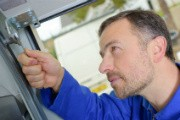 Tighten All The Screws And Bolts -Garage Door Maintenance Service • Elite Tech Garage Door Repair